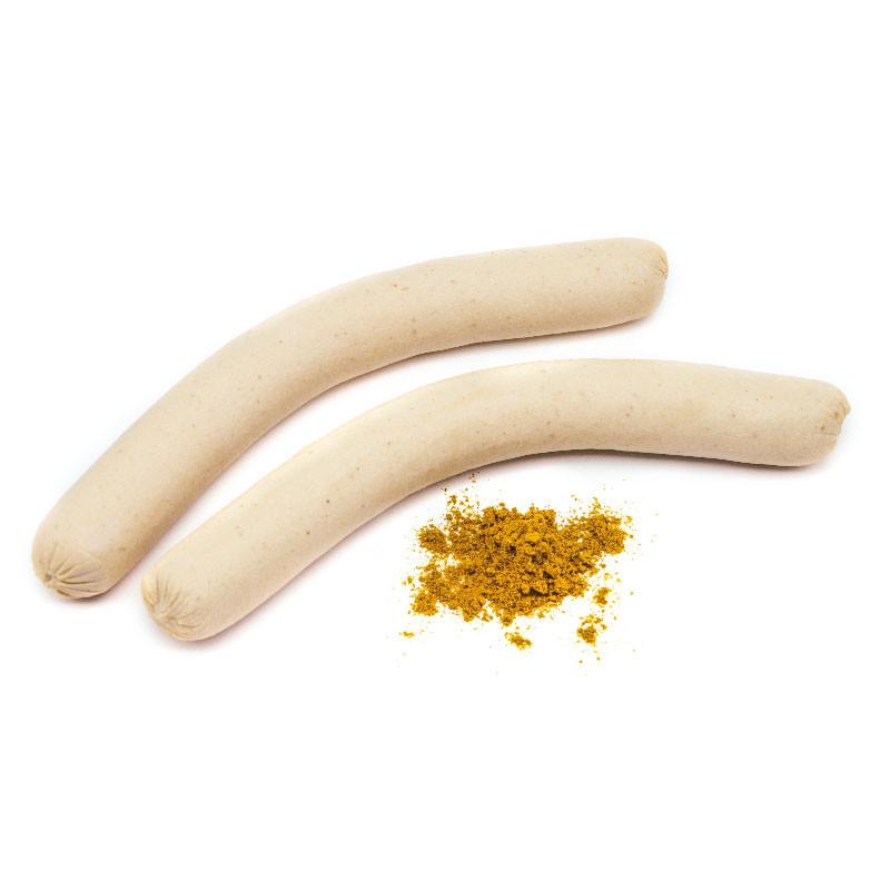 Zwei feine, gebrühte Kalbscurrywürste mit Currypulver